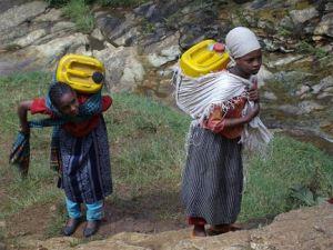women-carrying-water